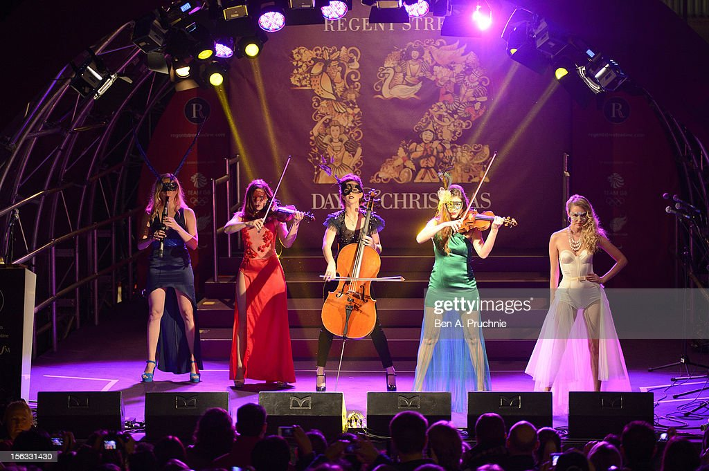 The Masques perform at the switch on of the Regent Street Christmas Lights at Regent Street on November 13, 2012 in London, England.