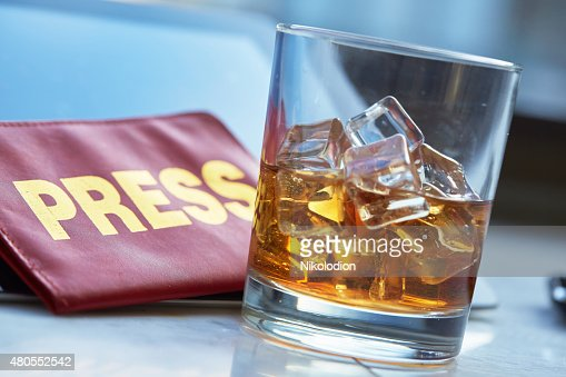 the mass media card, a glass of whiskey, tablet : Stock Photo