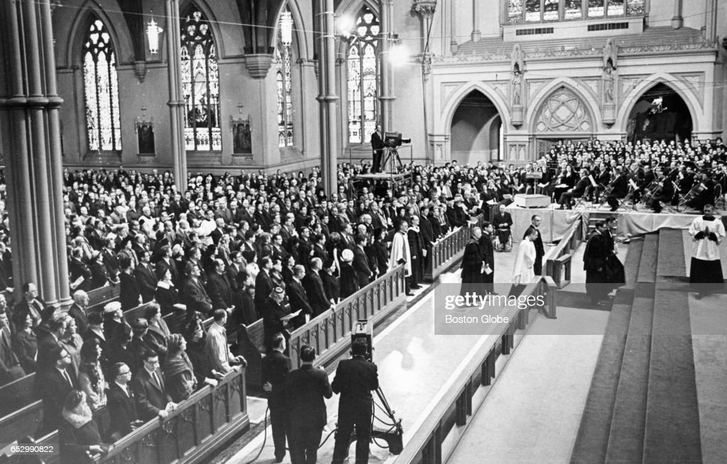 The Mass procession reaches the alter at Holy Cross Cathedral in Boston on Jan. 19, 1964, for a mass for John F. Kennedy. Kennedy was killed on Nov. 22, 1963.