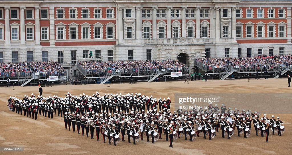The Massed Bands of Her Majesty's Royal Marines take part in the ceremony of Beating Retreat at Horse Guards Parade in central London, on May 26, 2016. Beating Retreat is performed every two years, and is a pageant of military music, precision drill and colour, and dates back to the 16th century. / AFP / JUSTIN