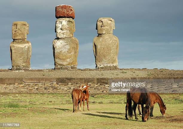 The massive stone sentinels of Ahu Tongariki seem imperious an uncompromising guard against the gluttonous sea crashing at its flank on Easter Island...