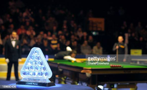 The Masters trophy sits at the edge of the arena during his quarterfinal match between Graeme Dott of Scotland and Judd Trump of England on day 6 of...