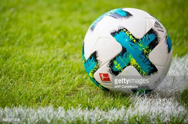 The match ball is seen on the pitch during the German First division Bundesliga football match VfL Wolfsburg v BVB Borussia Dortmund in Wolfsburg...
