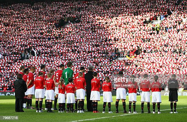 The Match Mascots wear the names of the dead of the Munich Air disaster as Manchester United Supporters and Players observe a minutes silence to...