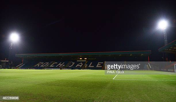 The match officials inspect the pitch ahead of the English FA Cup fourth round football match between Rochdale and Stoke City at Spotland Stadium in...