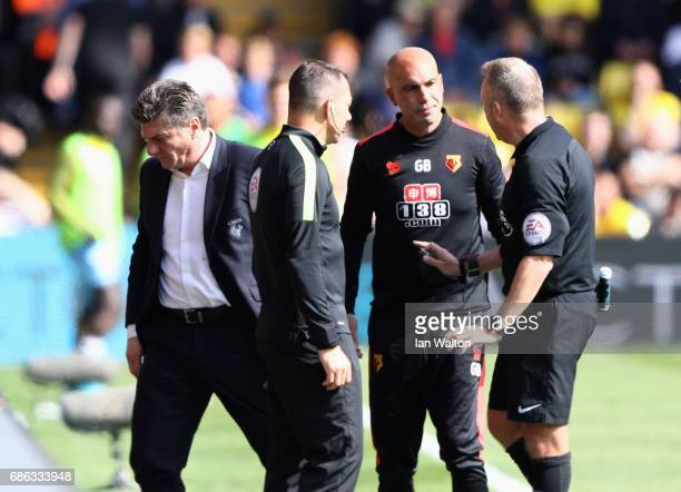 The match officials speak with Walter Mazzarri Manager of Watford during the Premier League match between Watford and Manchester City at Vicarage...