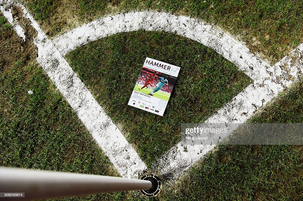 The match programme is placed in a corner quadrant prior to the the Emirates FA Cup Fourth Round Replay match between West Ham United and Liverpool at Boleyn Ground on February 9, 2016 in London, England.