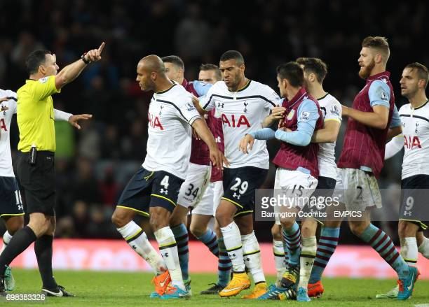 The match referee speaks with Tottenham Hotspur's Younes Kaboul Etienne Capoue Aston Villa's Ashley Westwood