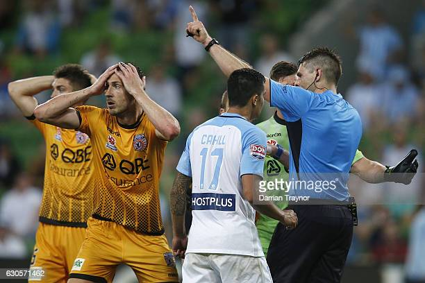 The match refereee gives a red card to Rostyn Griffiths as team mate Dino Djulbic of Perth Glory reacts during the round 12 ALeague match between...