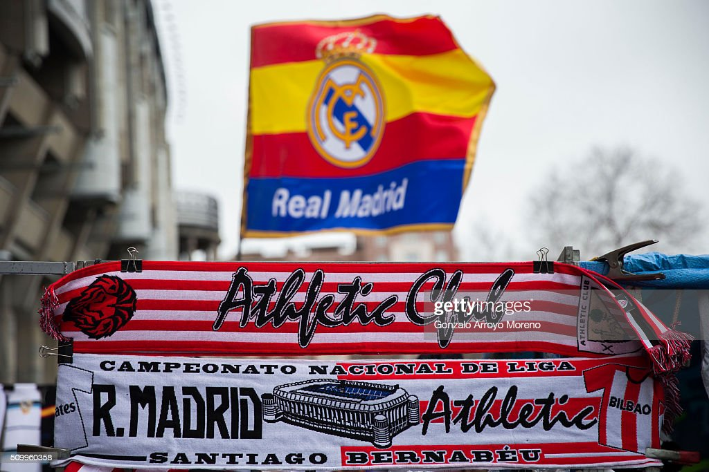 The match scarf is displayed behind an Athletic Club one at a merchandaising stall before the La Liga match between Real Madrid CF and Athletic Club at Estadio Santiago Bernabeu outdoors on February 13, 2016 in Madrid, Spain.