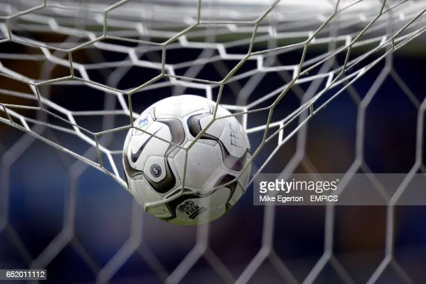 The matchball rests on top of the goalnetting