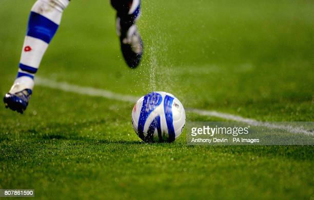 The matchball sprays up water as it rolls along the pitch
