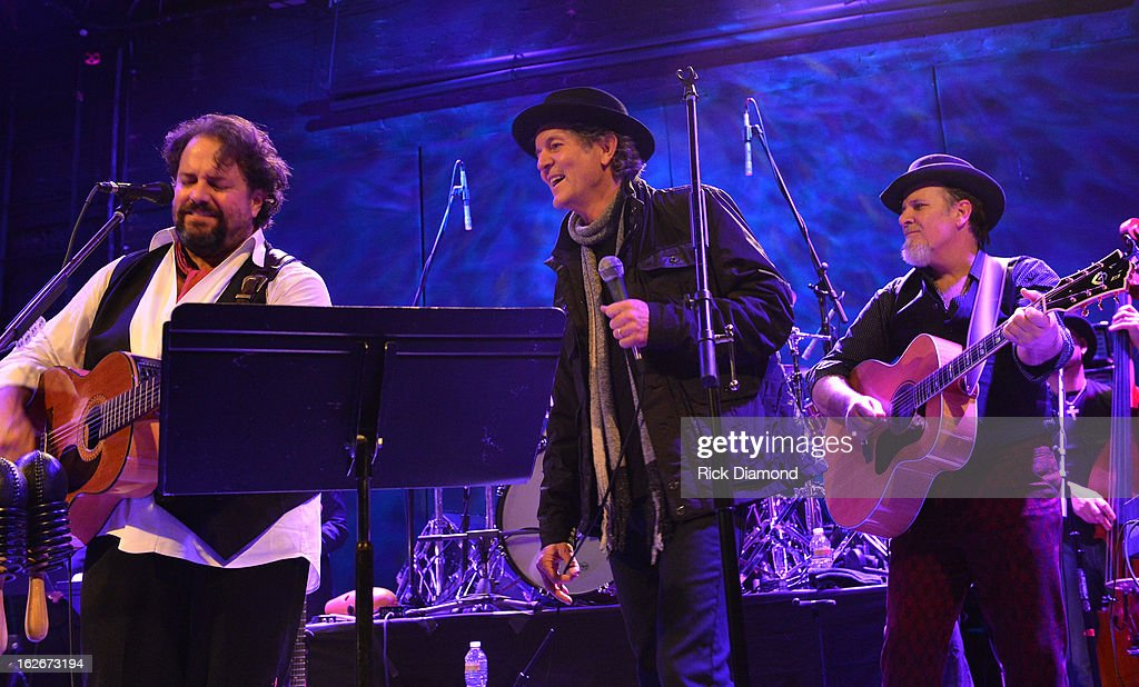 The Mavericks Raul Malo (left) and Robert Reynolds (right) are joined onstage by Singer/Songwriter <a gi-track='captionPersonalityLinkClicked' href=/galleries/search?phrase=Rodney+Crowell&family=editorial&specificpeople=653146 ng-click='$event.stopPropagation()'>Rodney Crowell</a> during The Mavericks Album release concert for there new album ' In Time' at The Bowery Ballroom on February 25, 2013 in New York City.