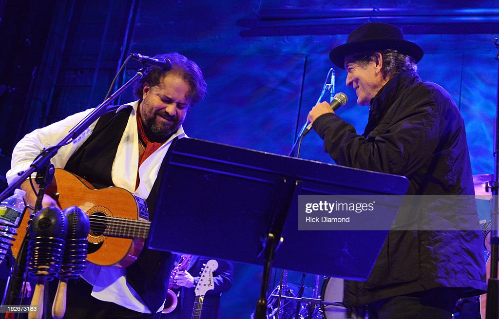 The Mavericks <a gi-track='captionPersonalityLinkClicked' href=/galleries/search?phrase=Raul+Malo&family=editorial&specificpeople=2159740 ng-click='$event.stopPropagation()'>Raul Malo</a> is joined onstage by Singer/Songwriter <a gi-track='captionPersonalityLinkClicked' href=/galleries/search?phrase=Rodney+Crowell&family=editorial&specificpeople=653146 ng-click='$event.stopPropagation()'>Rodney Crowell</a> during The Mavericks Album release concert for there new album ' In Time' at The Bowery Ballroom on February 25, 2013 in New York City.