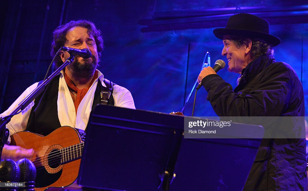 The Mavericks Raul Malo is joined onstage by Singer/Songwriter <a gi-track='captionPersonalityLinkClicked' href=/galleries/search?phrase=Rodney+Crowell&family=editorial&specificpeople=653146 ng-click='$event.stopPropagation()'>Rodney Crowell</a> during The Mavericks Album release concert for there new album ' In Time' at The Bowery Ballroom on February 25, 2013 in New York City.