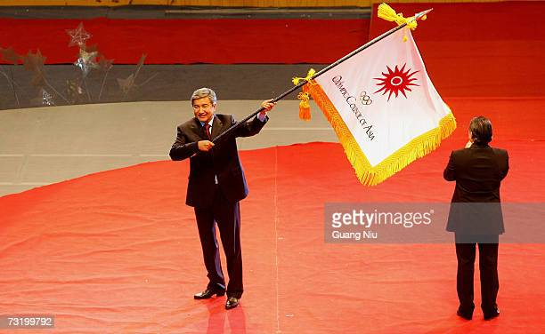 The mayor of Almaty city from Kazakhstan waves an Olympic council of Asia flag at the closing ceremony of the Sixth Asian Winter Games at Chuangchun...