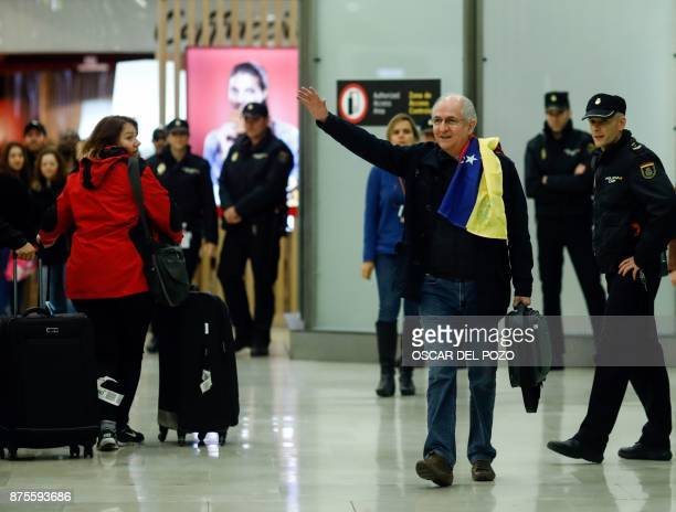 TOPSHOT The mayor of Caracas Antonio Ledezma waves upon his arrival to the Barajas Airport on November 18 2017 in Madrid Ledezma arrived from Bogota...