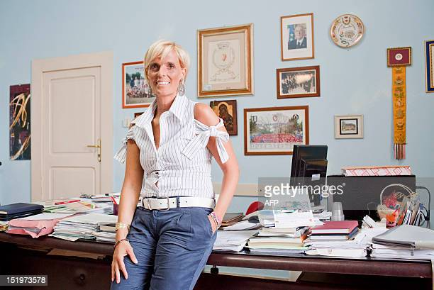 The mayor of Corigliano d'Otranto and a philosophy teacher Ada Fiore poses in her office on September 5 2012 in the small village of Corigliano...