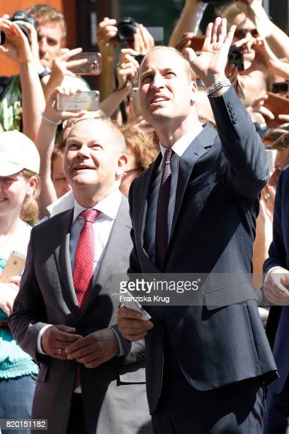 The Mayor of Hamburg Olaf Scholz and Prince William Duke of Cambridge visit the Hamburg Elbphilharmonie during an official visit to Poland and...