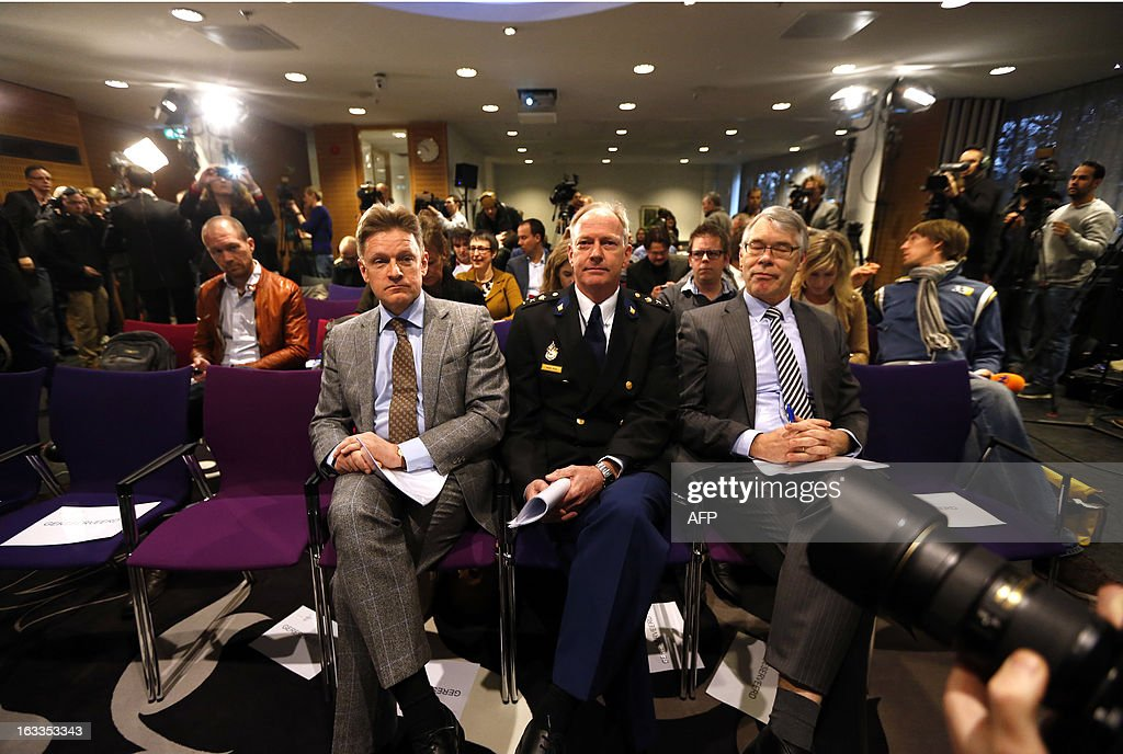 The Mayor of Haren Rob Bats, Police Chief Oscar Dros and Public Prosecutor Hessel Schuth attend on March 8, 2013 a presentation in Haren, The Netherlands, of the investigation report on the riots that occured in Haren on September 21, 2012. Police and the mayor of a sleepy Dutch town 'failed' in their handling of a riot triggered when thousands attended a party after receiving a Facebook invitation meant to be private, a probe found on March 8. Some 4,000 revellers descended onto the northern town of Haren in September after a local girl accidentally posted a public invitation for her 16th birthday party on the social network. AFP PHOTO / ANP / CATRINUS VAN DER VEEN -- The Netherlands out --
