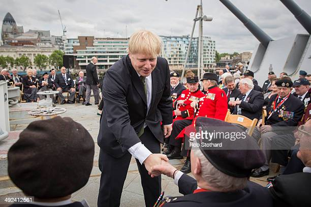 The Mayor of London Boris Johnson greets veterans aboard the HMS Belfast for the 70th anniversary DDay commemorations on May 20 2014 in London...