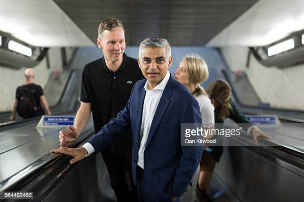 The Mayor of London Sadiq Khan rides an escalator during a photocall at Southwark Underground Station on July 29 2016 in London England The Photocall...