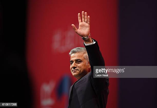 The Mayor of London Sadiq Khan waves as he addresses the Labour conference for the first time since his election on September 27 2016 in Liverpool...