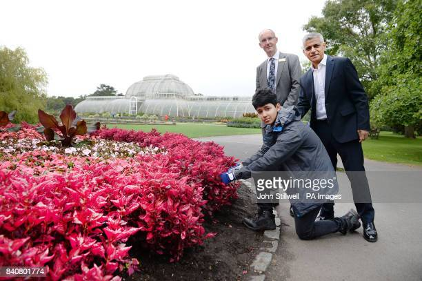 The Mayor of London Sadiq Khan with Director Richard of Kew Gardens Deverell and a student during a visit to the Royal Botanic Gardens Kew Richmond...