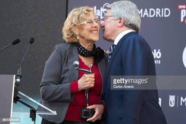 The Mayor of Madrid Manuela Carmena receives the Platino award to Madrid from producer Enrique Cerezo during the 'Platino Awards 2017' presentation...