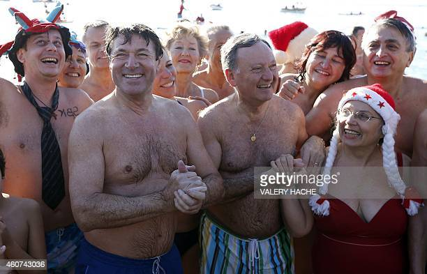 The Mayor of Nice Christian Estrosi and member of the National Assembly Rudy Salles take part in a traditional Christmas winter sea swimming on...