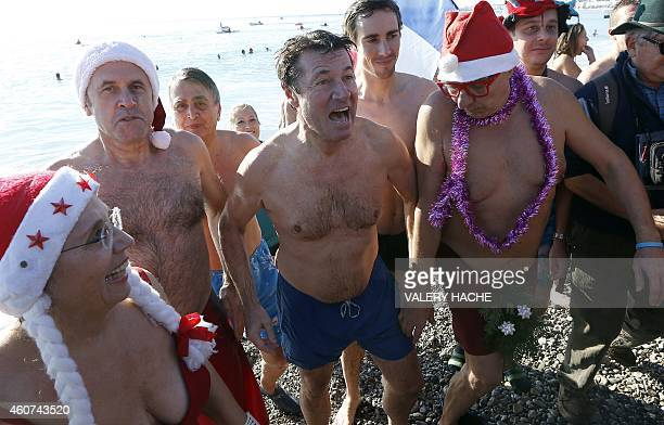 The Mayor of Nice Christian Estrosi comes out of the sea after taking part in a traditional Christmas winter sea swim on December 21 2014 in the city...