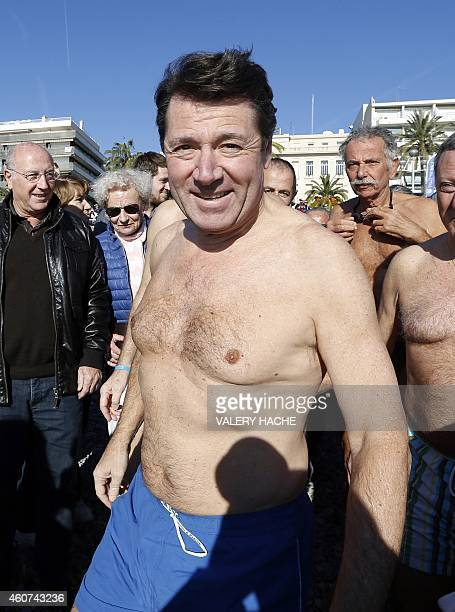 The Mayor of Nice Christian Estrosi readies to take part in a traditional Christmas winter sea swimming on December 21 2014 in the Mediterranean...