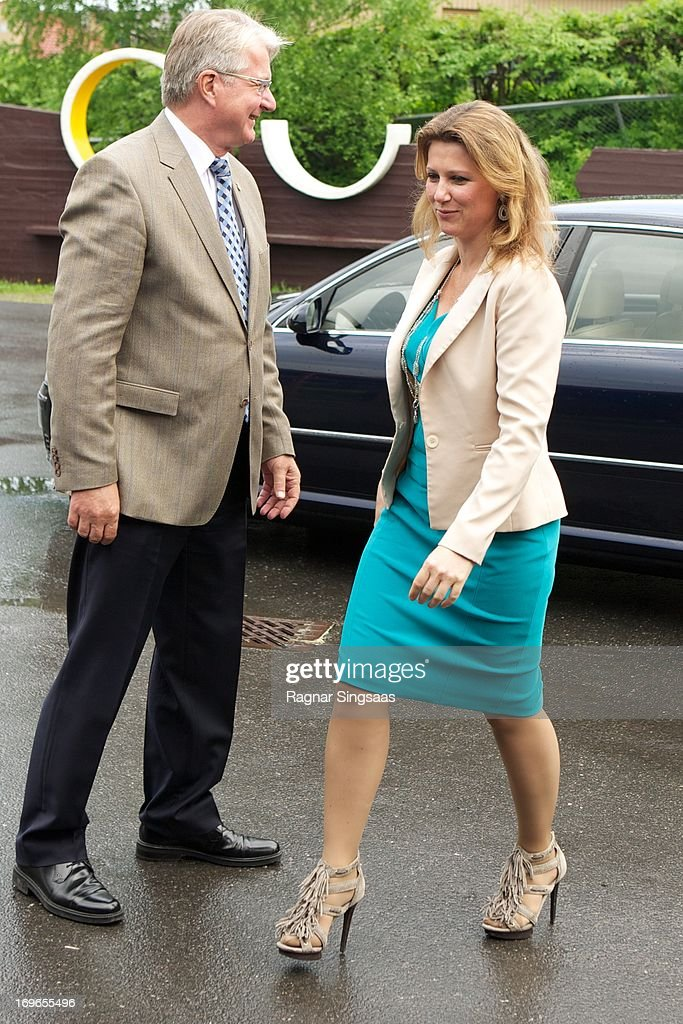 The Mayor of Oslo Fabian Stang (L) and Princess Martha Louise of Norway Visit Haukasen Elementary School on the School's 40th Anniversary, on May 30, 2013 in Oslo, Norway.