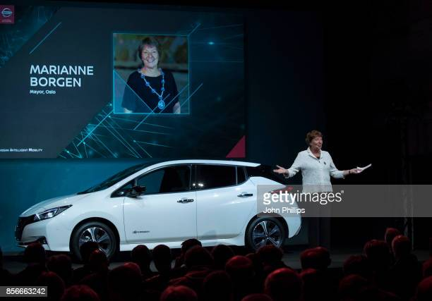 The Mayor of Oslo Marianne Borgen speaks to members of the press during the unveiling of the new 100% electric Nissan LEAF at Nissan's Futures 30...