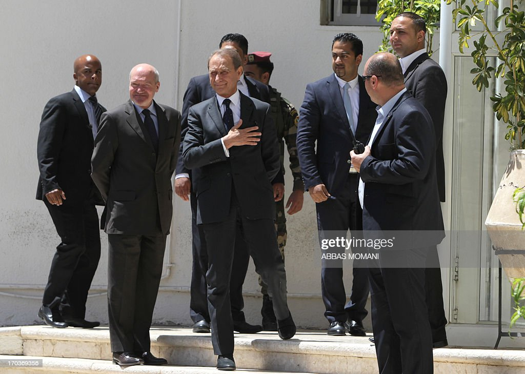 The Mayor of Paris Bertrand Delanoë (C) gestures as he arrives in the West Bank city of Ramallah, on June 12, 2013, for a meeting with Palestinian leader Mahmud Abbas.