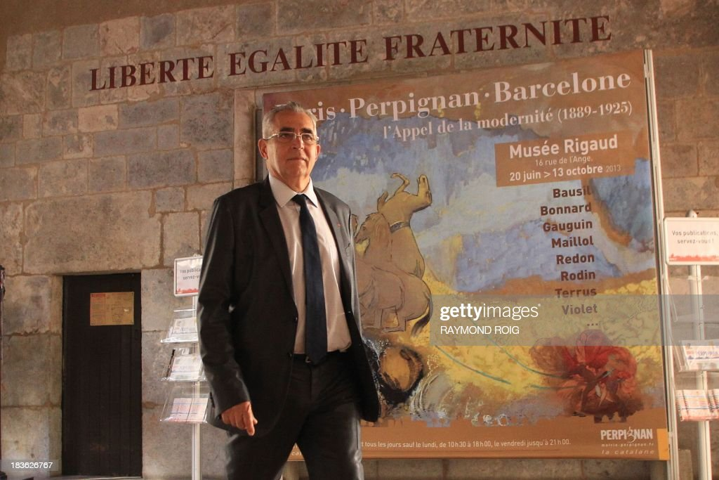 The mayor of Perpignan, Jean-Marc Pujol, poses at the town hall on October 7, 2013 in Perpignan. Pujol, from the main right-wing opposition UMP (Union for a Popular Movement ) party, is candidate for his own succession in the March 2014 municipal elections. AFP PHOTO / RAYMOND