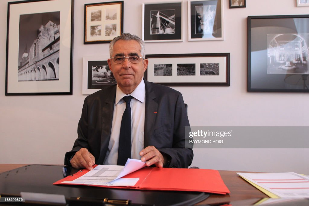 The mayor of Perpignan, Jean-Marc Pujol, poses in his office on October 7, 2013 in Perpignan. Pujol, from the main right-wing opposition UMP (Union for a Popular Movement ) party, is candidate for his own succession in the March 2014 municipal elections. AFP PHOTO / RAYMOND