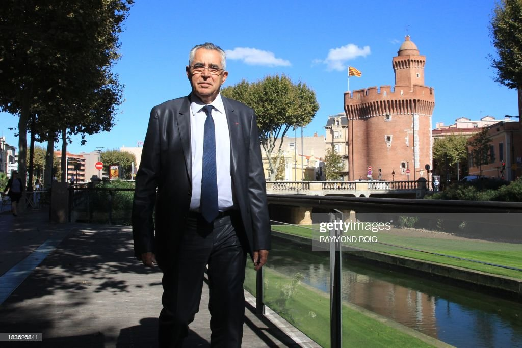 The mayor of Perpignan, Jean-Marc Pujol, walks on October 7, 2013 in Perpignan. Pujol, from the main right-wing opposition UMP (Union for a Popular Movement ) party, is candidate for his own succession in the March 2014 municipal elections. AFP PHOTO / RAYMOND