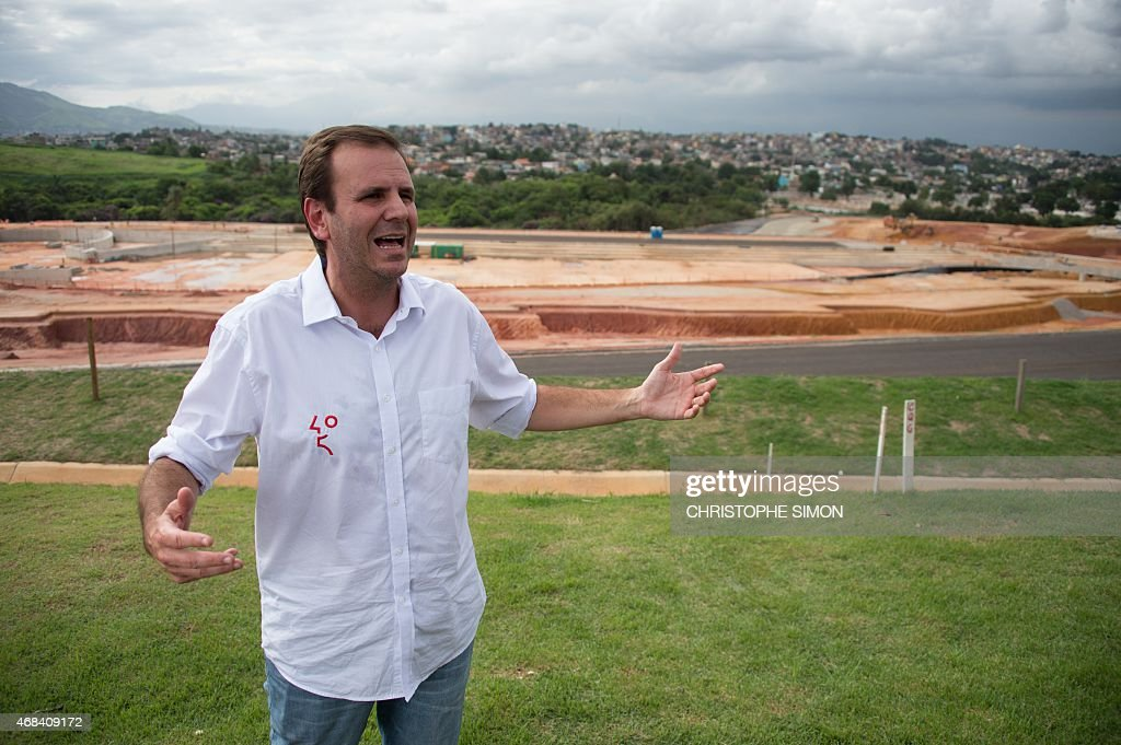 The mayor of Rio de Janeiro Eduardo Paes gestures as he speaks with journalists at the Deodoro Olympic Park site which will host several sports...