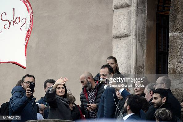 ROME ITALY FEBRUARY The mayor of Rome Virginia Raggi accompanied by Marcello De Vito greets supporters demonstrating in the Capitol in his support on...