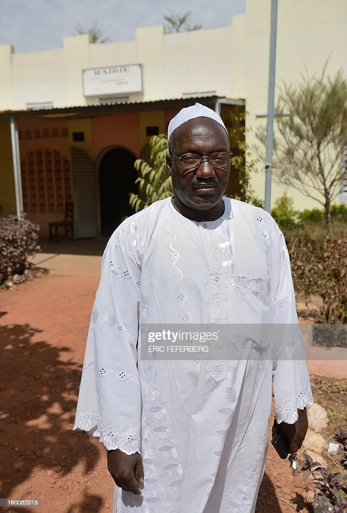 The Mayor of Serribala, Baba Diarra, stands in the gardens of the city hall in Siribala, 20 kms from Niono, on January 25, 2013, after two Malian people were shot dead in the city on January 24 allegedly by the Malian Army. French and Malian troops advanced on the key Islamist stronghold of Gao after recapturing the northern town of Hombori as the extremists bombed a strategic bridge to thwart a new front planned in the east. The French-led assault against the radical Islamists controlling northern Mali entered its third week with a strong push into the vast semi-arid zone amid rising humanitarian concerns for people in the area facing a dire food crisis. AFP PHOTO / ERIC FEFERBERG