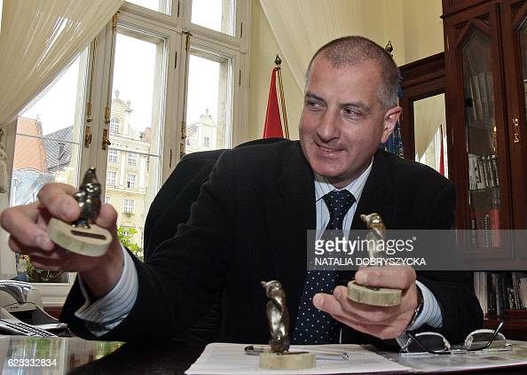 The mayor of the southwestern Polish city of Wroclaw Rafal Dutkiewicz shows figurines in his office 12 October 2007 The booming city has become a...