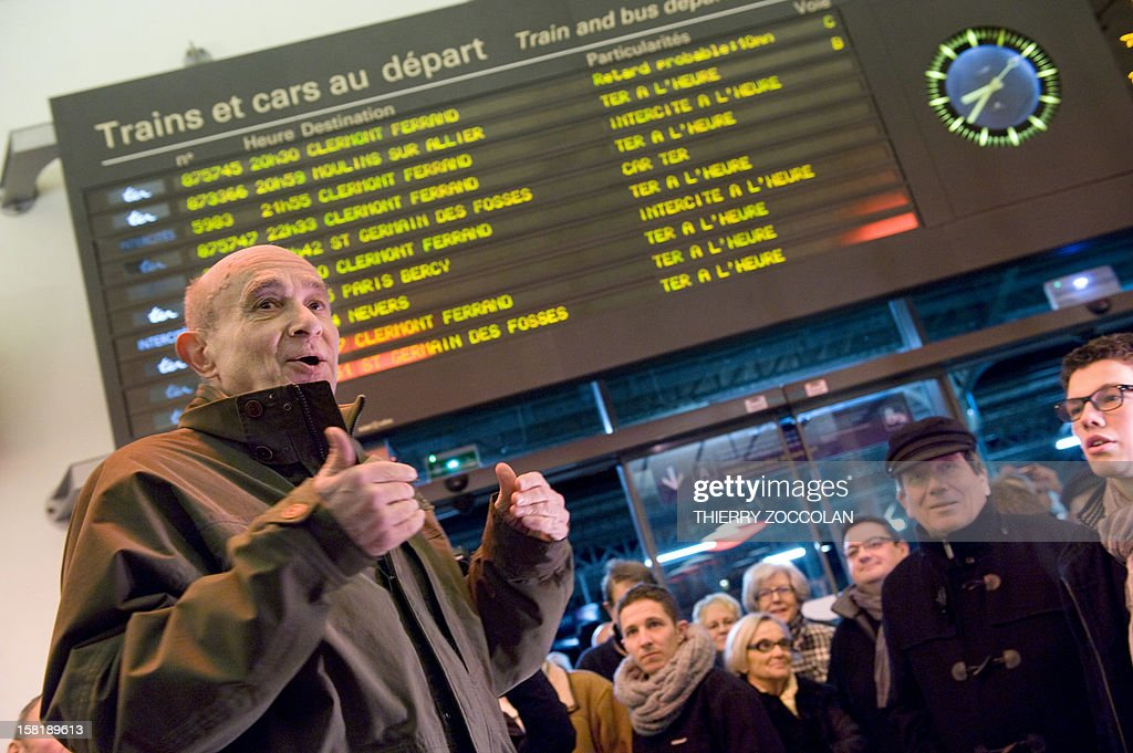 The mayor of Vichy, Claude Malhuret (L) speaks as he takes part in a demonstration to block a train commuting from Paris to Clermont-Ferrand, on December 10, 2012 at the railway station in Vichy, central France. Local elected officials from Nevers, Moulins and Vichy protested against new time schedules planned by French national rail company SNCF and the cancellation of these three locations as a stop from Paris to Clermont-Ferrand.