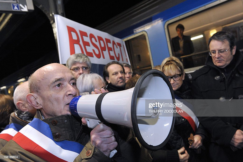 The mayor of Vichy, Claude Malhuret (L) speaks beside other local elected officials as he takes part in a demonstration to block a train commuting from Paris to Clermont-Ferrand, on December 10, 2012 at the railway station in Vichy, central France. Local elected officials from Nevers, Moulins and Vichy protested against new time schedules planned by French national rail company SNCF and the cancellation of these three locations as a stop from Paris to Clermont-Ferrand.