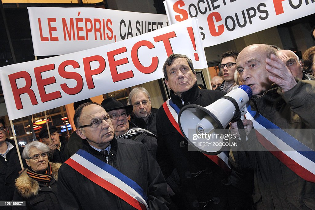 The mayor of Vichy, Claude Malhuret (R) speaks beside other local elected officials as he takes part in a demonstration to block a train commuting from Paris to Clermont-Ferrand, on December 10, 2012 at the railway station in Vichy, central France. Local elected officials from Nevers, Moulins and Vichy protested against new time schedules planned by French national rail company SNCF and the cancellation of these three locations as a stop from Paris to Clermont-Ferrand.