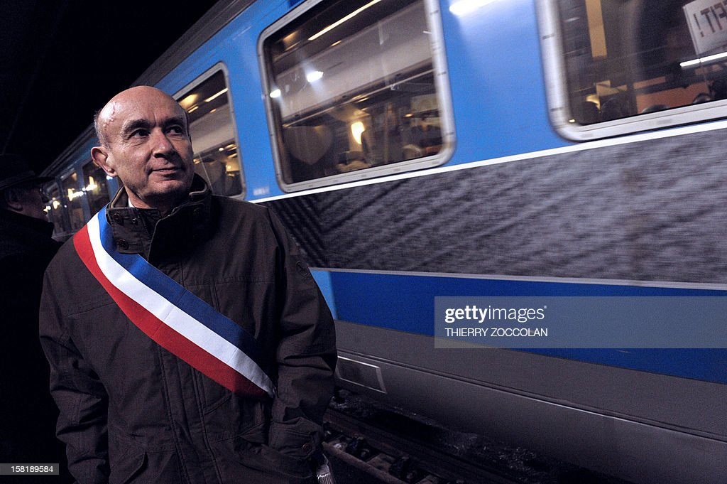 The mayor of Vichy, Claude Malhuret takes part in the blocking of a train commuting from Paris to Clermont-Ferrand, on December 10, 2012 at the railway station in Vichy, central France. Local elected officials from Nevers, Moulins and Vichy protested against new time schedules planned by French national rail company SNCF and the cancellation of these three locations as a stop from Paris to Clermont-Ferrand.