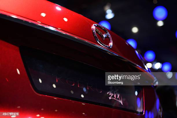 The Mazda Motor Corp badge is displayed on the Koeru concept vehicle at the Tokyo Motor Show in Tokyo Japan on Wednesday Oct 28 2015 Toyota Motor...