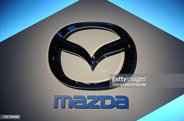 The Mazda motors logo is displayed during the Mazda NextGeneration Technology Forum in Tokyo on October 20 2010 AFP PHOTO / TOSHIFUMI KITAMURA