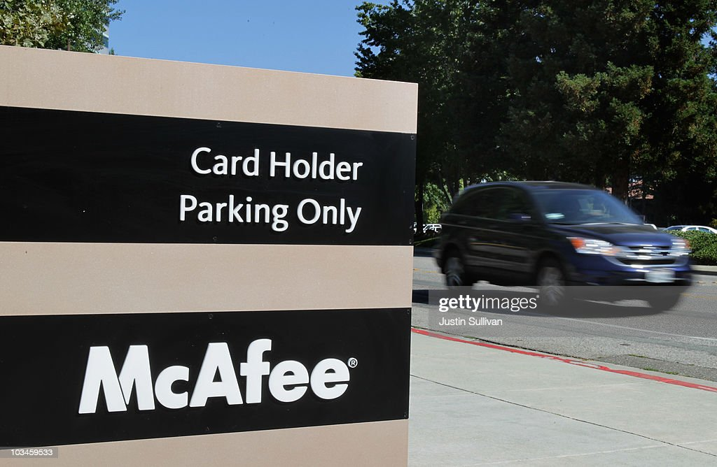 The McAfee logo is displayed on a sign for the parking lot outside of the company's headquarters August 19, 2010 in Santa Clara, California. Intel announed today that it plans to buy security software maker McAfee for a reported $7.68 billion.