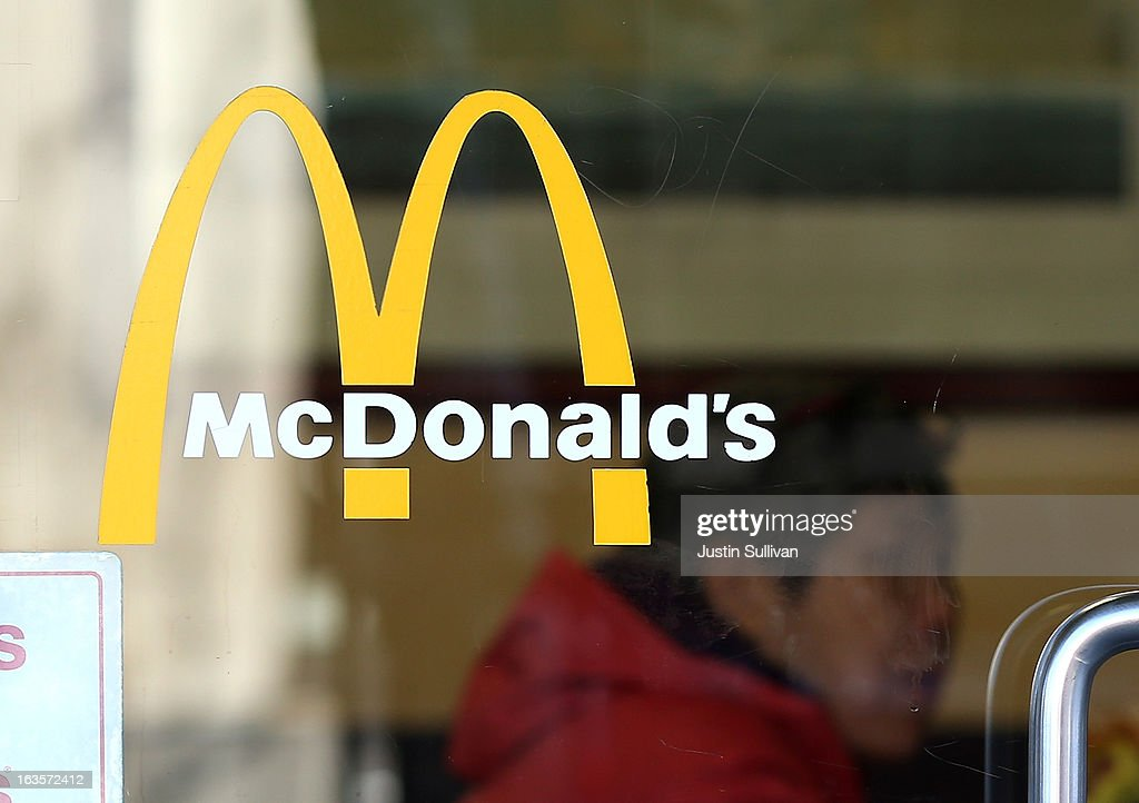 The McDonald's logo is posted in the window of a McDonald's restaurant on March 12 2013 in San Francisco California McDonald's has retained its...